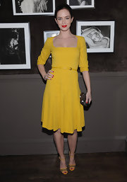 Emily Blunt looked phenom at the Elie Saab private dinner in this square-neck saffron frock.