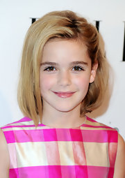 Kiernan looked as cute as can be in a pink checkered dress and short bob.