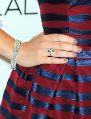 Alyson paired her striped dress with gray neutral nail polish. A nice alternative to black.