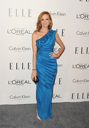 Jayma Mays loves to wear vibrant colors! The stunning red head stepped out in an iridescent blue one-shoulder gown.