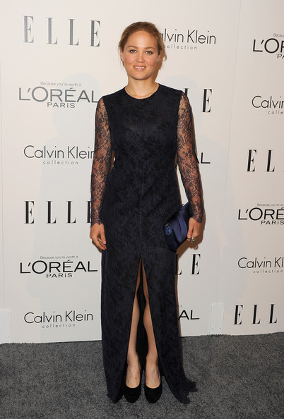 Erika Christensen paired her dark lacy gown with black suede platform pumps with studded detailing.