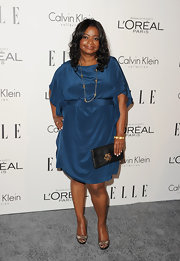 Octavia Spencer paired her jewel-toned frock with bronze peep-toe pumps.