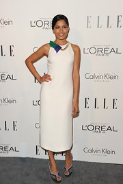 Freida Pinto added a pop of color to her simple white dress with colorful peep-toe pumps.