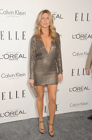 Jennifer Aniston accented her sultry mini dress with a sleek gold frame clutch.