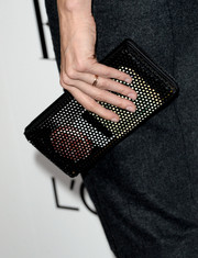 Lake Bell attended the Elle Women in Hollywood celebration carrying an industrial-looking black mesh clutch.