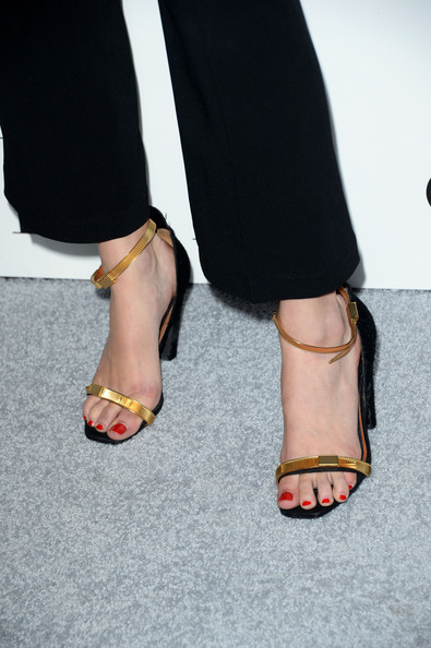 Gia Coppola complemented her dark outfit with a pair of gold evening sandals for a bit of shine at the Elle Women in Hollywood celebration.