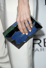 Darby Stanchfield accessorized with an ultra-modern multitextured box clutch by Emm Kuo when she attended the Elle Women in Hollywood celebration.