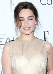 Emilia Clarke smoldered with this messy updo at the Elle Women in Hollywood celebration.