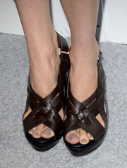 Shailene Woodley opted for casual brown strappy sandals when she attended the Elle Women in Hollywood celebration.