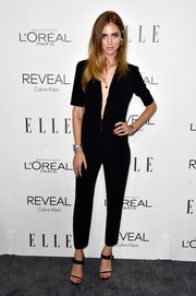 Chiara Ferragni chose a pair of black strappy sandals to team with her jumpsuit.