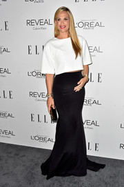 Molly Sims paired her top with a floor-sweeping black skirt for a more glamorous finish.