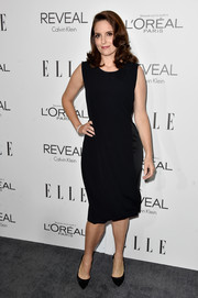 Tina Fey cut a curvy silhouette in her Calvin Klein LBD during the Elle Women in Hollywood event.