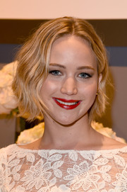 Jennifer Lawrence punched up her look with a super-red lip.