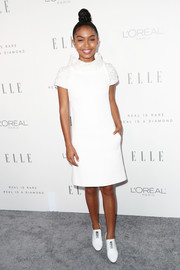 Yara Shahidi chose a simple funnel-neck LWD by Chanel for Elle's Women in Hollywood celebration.