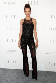 Alessandra Ambrosio looked sultry in a partially sheer jumpsuit by Zuhair Murad during Elle's Women in Hollywood celebration.