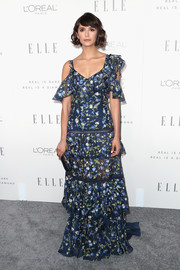 Nina Dobrev looked downright darling in an asymmetrical floral-embroidered gown by Prabal Gurung during Elle's Women in Hollywood celebration.