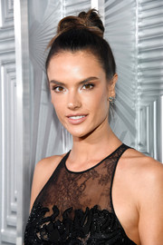 Alessandra Ambrosio kept it youthful and trendy with this top knot during Elle's Women in Hollywood celebration.