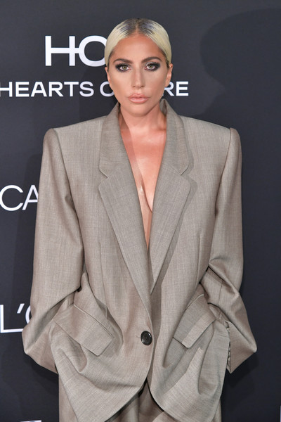 More Pics of Lady Gaga Pantsuit (5 of 16) - Suits Lookbook - StyleBistro [elle,hearts on fire,loreal paris,red carpet,suit,fashion model,formal wear,fashion,outerwear,gentleman,blazer,model,flooring,tuxedo,los angeles,beverly hills,california,25th annual women in hollywood celebration,calvin klein,lady gaga]