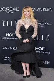 Natasha Lyonne glammed up in a black fishtail dress with a studded illusion neckline and sleeves at the 2018 Elle Women in Hollywood celebration.