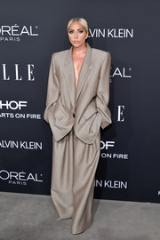 Lady Gaga went androgynous in an oversized taupe pantsuit by Marc Jacobs at the 2018 Elle Women in Hollywood celebration.