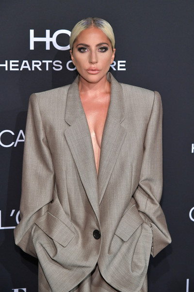 More Pics of Lady Gaga Pantsuit (1 of 16) - Suits Lookbook - StyleBistro [elle,hearts on fire,loreal paris,red carpet,clothing,suit,hairstyle,outerwear,fashion,formal wear,pantsuit,blazer,model,long hair,los angeles,beverly hills,california,25th annual women in hollywood celebration,calvin klein,lady gaga]
