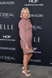 Malin Akerman teamed a dusty-pink hard-case clutch by Cushnie with a matching leather dress for the 2018 Elle Women in Hollywood celebration.