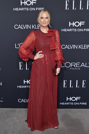 Molly Sims got dolled up in a red sequined gown with bow detailing for the 2018 Elle Women in Hollywood celebration.