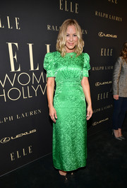 Maria Bello chose a bright-green column dress by Saloni for the 2019 Elle Women in Hollywood celebration.