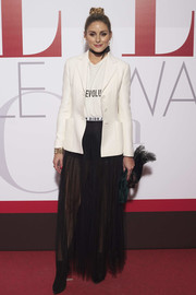 Olivia Palermo layered a white blazer over a matching tee, both by Dior, for the Elle 30th anniversary party.