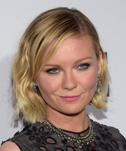 Kirsten Dunst amped up the girly appeal with a pink lip.