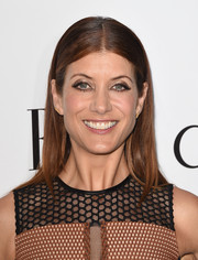 Kate Walsh styled her hair in a classic center part.