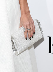 Sarah Hyland's beaded glittery clutch fitted right in with her head-to-toe white look.