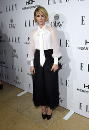 Sarah Paulson arrived at ELLE's Annual Women in Television Celebration looking fabulous in head-to-toe Badgely Mischka, including a white mesh sleeved blouse.