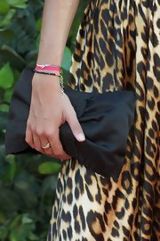 A black satin clutch is the perfect accessory for a leopard print dress.