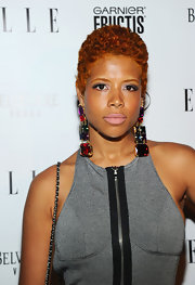 Kelis rocked large gemstone earrings while hitting the red carpet at the ELLE Awards.