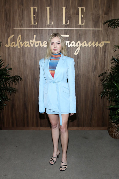 Peyton List attended the Elle & Ferragamo Hollywood Rising celebration wearing a pastel-blue skirt suit with a multicolored turtleneck.