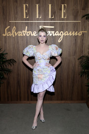 Lucy Boynton donned a lavender floral blouse with puffed sleeves for the Elle & Ferragamo Hollywood Rising celebration.