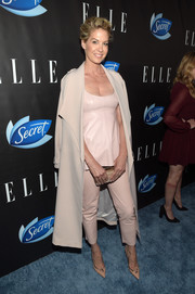 Underneath her coat, Jenna Elfman was cute in cropped pink leather pants and a matching top.