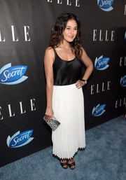 Emmanuelle Chriqui polished off her look with a printed box clutch by Emm Kuo.