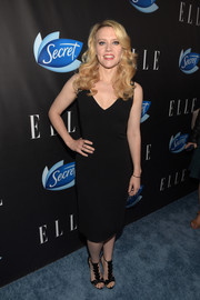 Kate McKinnon glammed up her look with a pair of bowed satin T-strap sandals.