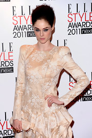 Coco Rocha perfectly matched her nude brocade knuckle duster clutch to her bold-shouldered frock at the Elle Style Awards.
