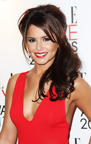 Cheryl Cole highlighted her plunging neckline with a half up hairstyle complete with side swept bangs.