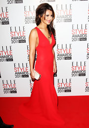 Cheryl Cole accented her gorgeous red gown with a white Knuckle Duster clutch.
