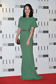 Laura Haddock wore a sage evening dress with a bow belt to the Elle Style Awards.