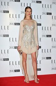 Rosie Huntington-Whiteley paired a pearlized Edie Parker clutch with an embellished dress for a shimmery look during the Elle Style Awards.