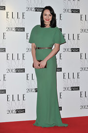 Smiling sweetly at the Elle Style Awards 2012, Laura Haddock was elegance personified in her pale green gown with a metallic waist belt.