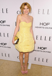 Bella Thorne loaded up on the pastels, pairing her yellow dress with pink Prada sandals.