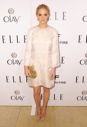 Emily Wickersham complemented her dress with an embellished gold frame clutch by Dolce & Gabbana for a totally classy look.