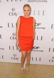 Malin Akerman teamed her dress with fierce white strappy sandals by Chelsea Paris for a chicer finish.