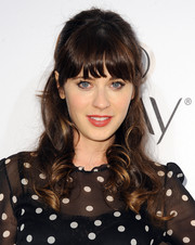 Zooey Deschanel charmed at the Elle Women in Television celebration with her youthful half-up curly 'do.
